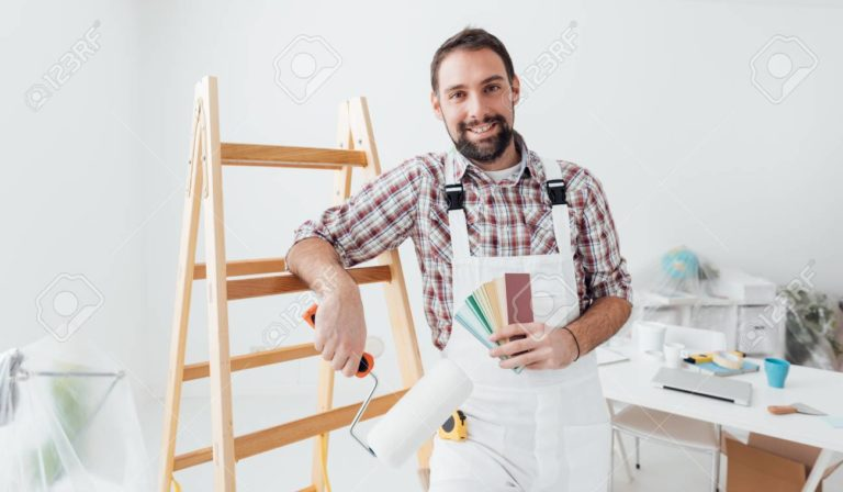 confident-professional-painter-posing-he-is-holding-a-paint-roller-and-color-swatches-home-renovatio-768x448.jpg