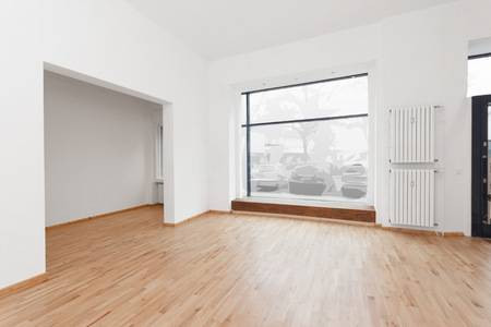 52437757-renovated-room-with-shopping-window-empty-store-shop-with-wooden-floor-and-whitewalls.jpg
